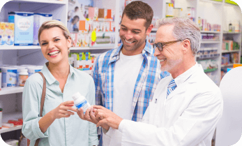 couple and pharmacist laughing