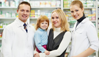 pharmacists and customer smiling